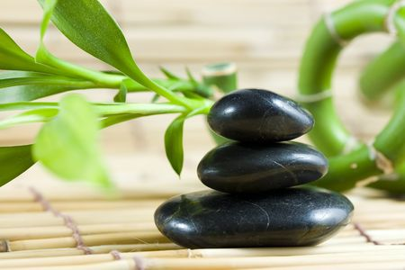 spirituality therapy: 3 balanced pebbles stones with bamboo