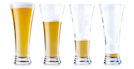 empty glass: Four glasses of beer in various stages, from full to empty