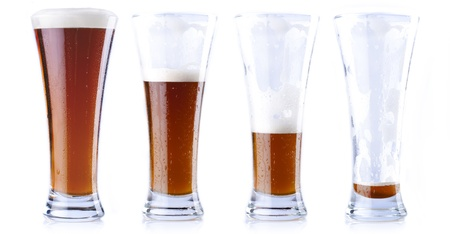 pint glass: Four glasses of beer in various stages, from full to empty