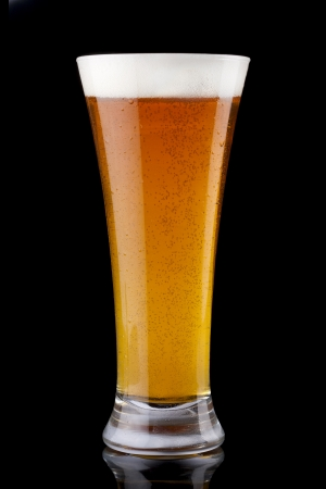 pint: Glass of fresh beer on a black background Stock Photo