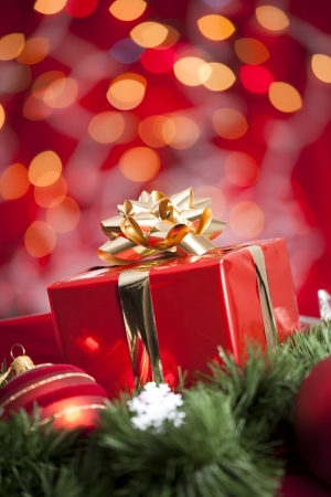 giving season: A beautiful red gift with Christmas ornaments
