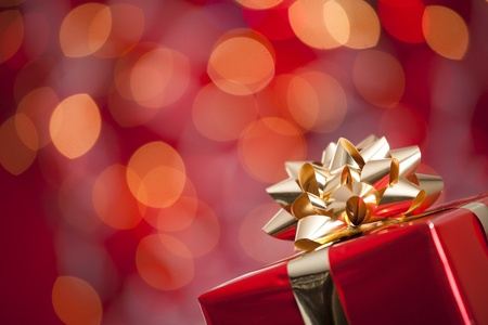 giving gift: A beautiful red gift with Christmas ornaments