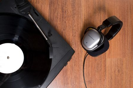 record player and earpieces on parquee of wood Stock Photo - 6615628
