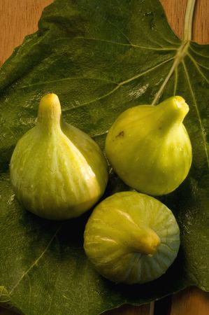 set of figs on fig tree leaves Stock Photo - 6615559