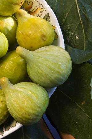 set of figs on fig tree leaves Stock Photo