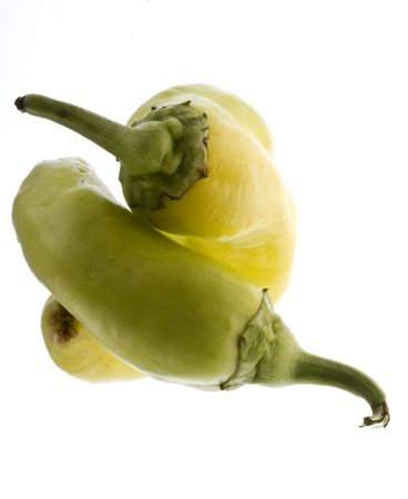 Couple of small green peppers isolated Stock Photo