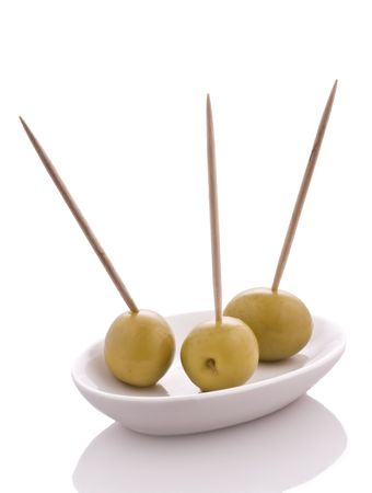 Plate with three olives with toothpicks, isolated Stock Photo