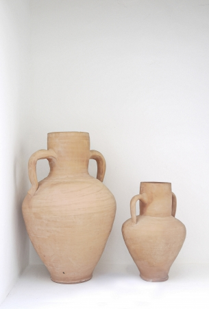 Two clay pitcher in a white wall Stock Photo - 14661849