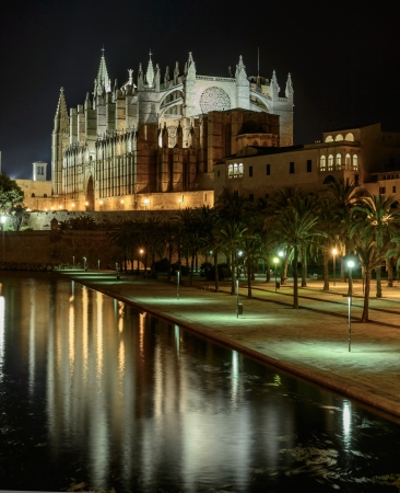Gothic facade of the cathedral of Palma de Majorca and views of  Sea Park  photo