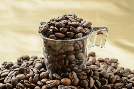 Coffee beans in a glas cup