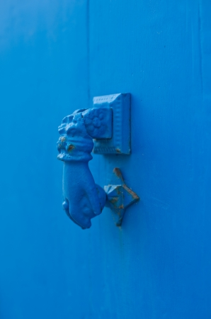 Door handle knocker painted blue photo