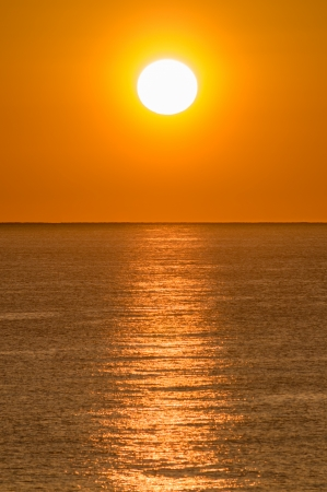 Sunrise or sun up is the instant at which the upper edge of the Sun appears over the eastern horizon in the morning  Stock Photo - 21577439