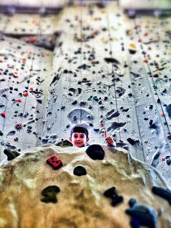 climbing  wall: Kid in a climbing wall