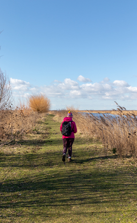 Person hiking with a backpack in a beautiful natural landscape on a sunny day