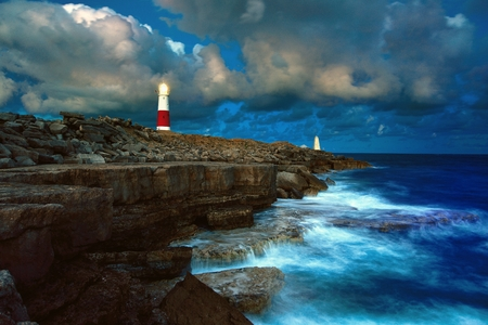 switched: The light of Portland Bill Lighthouse is switched on as the night falls.
