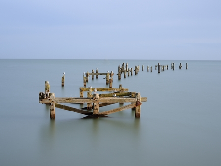 but think: A long exposure on the Swanage Old Pier. I just managed to get a ray of sunlight between clouds to illuminate the pier. The long exposure (30sec) meant that the seagulls are blurry, but I think they make a lively addition to the scenery. Stock Photo