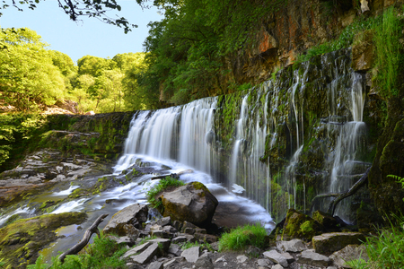 brecon beacons: Sgwd Isaf Clun-gwyn Waterfall in Brecon Beacons Wales UK Stock Photo