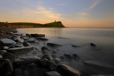 kimmeridge: Summer Sunset at Kimmeridge Bay. Long exposure to blur the water movement between the rocks.