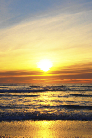 sunset at piha beach, new zealand