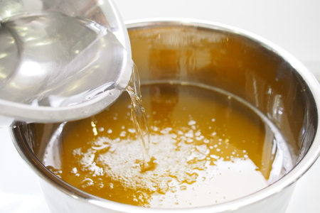 Process of homemade soap, mixing lye solution into oil