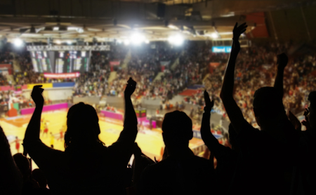 crowd cheering at basketball stadium
