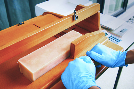 cutting homemade soap with wooden soap cutter
