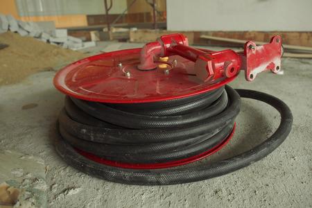 Fire hose reel at a construction site Standard-Bild