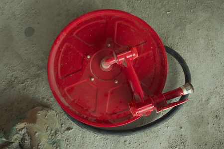Fire hose reel at a construction site 写真素材