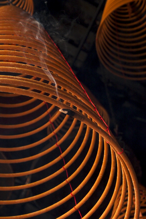 circular incense hanging in the temple