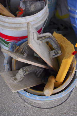plastic cement buckets with other construction tools Standard-Bild