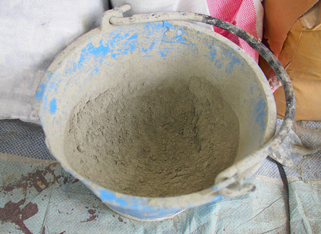bucket with cement powder used in construction site