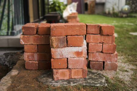 pile of stacked red bricks