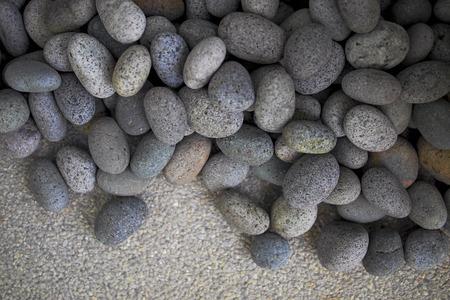close up grey round pebbles