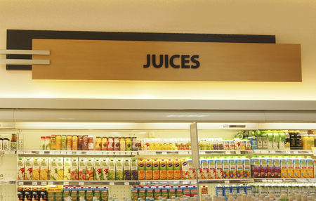 Kuala Lumpur, Malaysia - August 16 2016: wide range of fruit juices on the shelves in supermarket Editorial