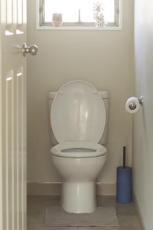 white toilet bowl in a bathroom Standard-Bild