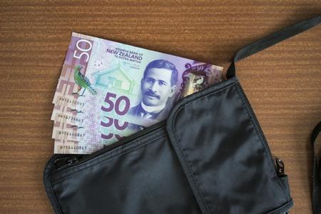 cash in a travel neck pouch Standard-Bild