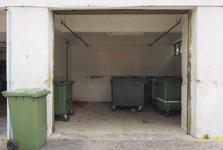Green garbage containers in garbage room Standard-Bild
