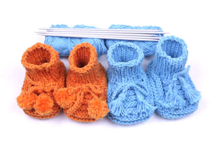 Close up look on woollen baby shoes isolated in white.  photo