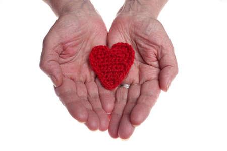 d�livrance: C?ur de laine donnant des mains de la vieille femme