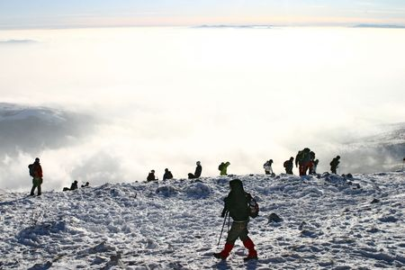 mountin: A group of mountin climbers above the clouds at mountain
