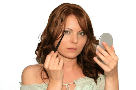 eye liner: Girl is using her make up collection in several phases, eye liner Stock Photo