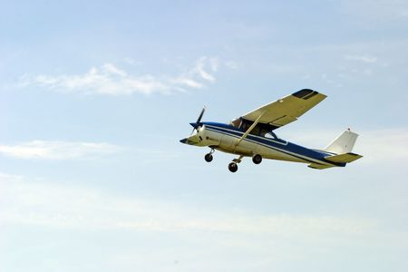 Agricultural plane is flying above horizon photo