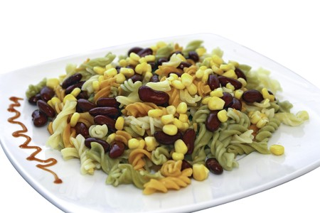 Mediterranean pasta with red beans and sweet corn at the plate Stock Photo