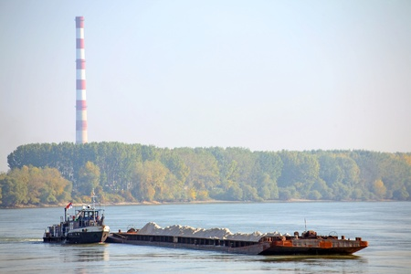 Cargo ship at the Danube with heating plant at background, central Europe Stock Photo - 8285327