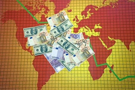 Money at the world map with falling diagram photo