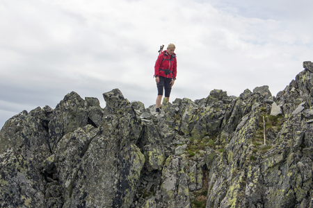 abyss: Girl is walking on the edge of abyss - Slovakian mountains