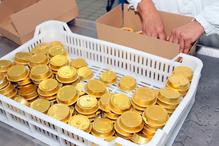 canned meat: Packing of canned pate at meat factory Stock Photo