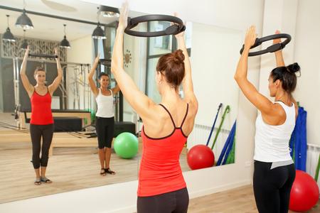 pilates woman: Girls are exercising pilates with pilates discs