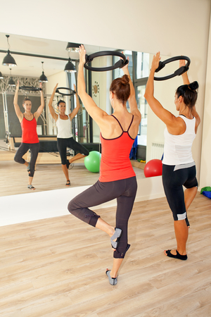 trainer device: Girls are exercising pilates with pilates discs