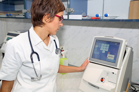 Doctor use equipment for blood gases analysis at laboratory Stock Photo